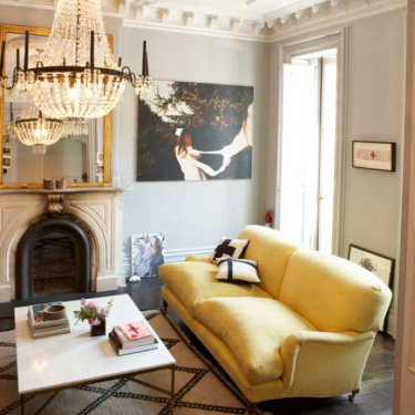 Living-room-with-yellow-sofa-and-soft-grey-walls